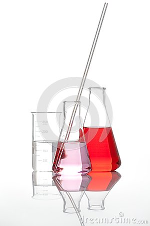 Glass flasks with a red liquid