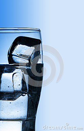 Glass with fresh cool water and ice