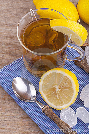 Glass with fresh hot lemon tea
