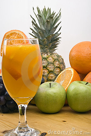 Glass with fresh orange juice and fruits