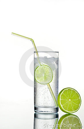 Glass of gin and tonic with ice and lime