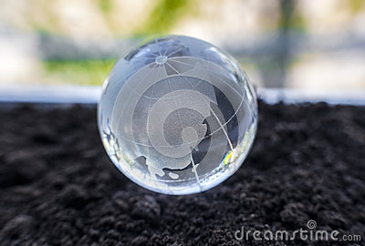 Glass globe on the ground
