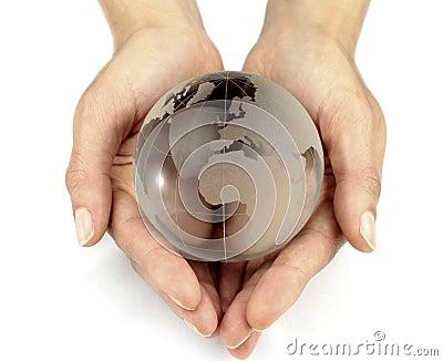 Glass globe in hands