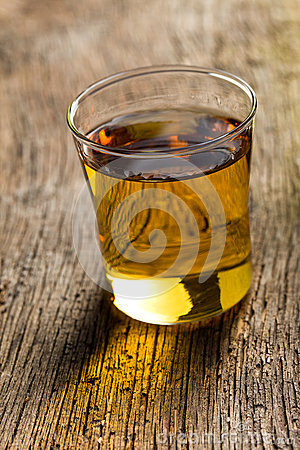 Glass of golden alcohol