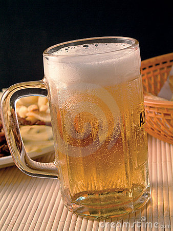 A glass with golden lager beer