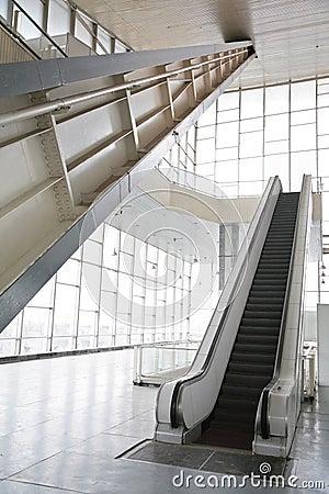 Glass hall with escalator