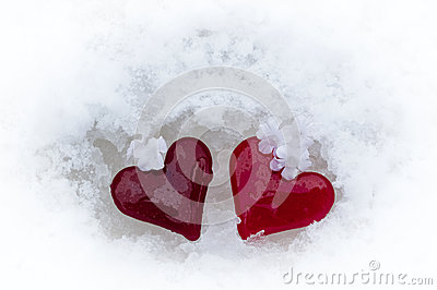 Glass hearts in melting snow
