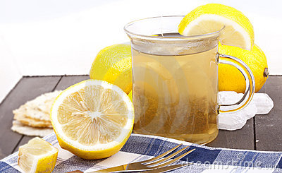 Glass with hot lemon tea