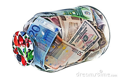Glass jar or bank full of different nominal money