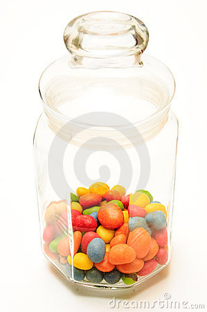 A glass jar with colored candies