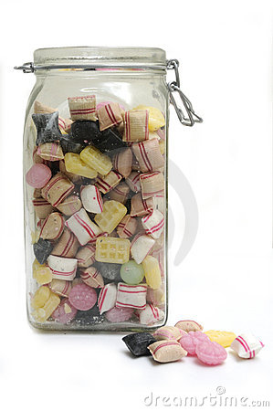 Glass jar full of colorful candies.