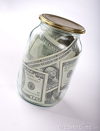 Glass jar full of dollar banknotes