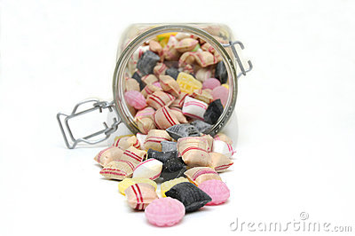 Glass jar full of mixed candies.