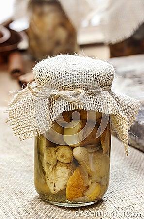 Glass jar of pickled mushrooms
