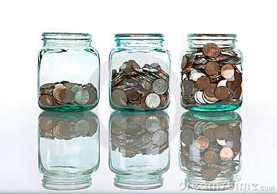 Glass jars with coins - savings concept