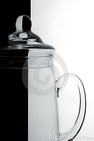 Glass jug on a black-and-white background