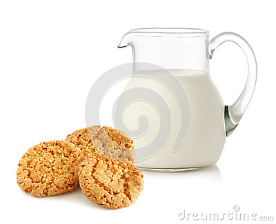 Glass jug with milk and cookies