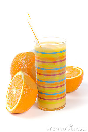Glass of juice and oranges
