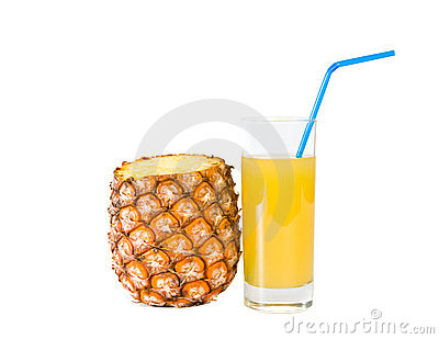 The glass of  juice and ripe pineapple