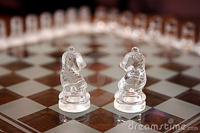 Glass knight chess pieces