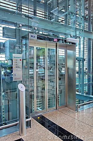 Glass lift lobby in airport building