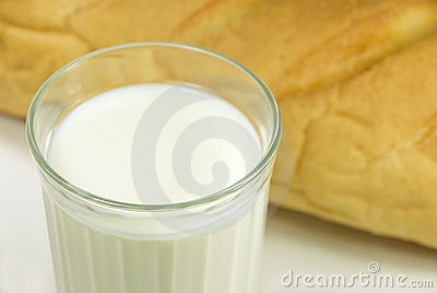 Glass with milk and bread