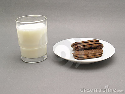 Glass of milk with chocolate biscuits