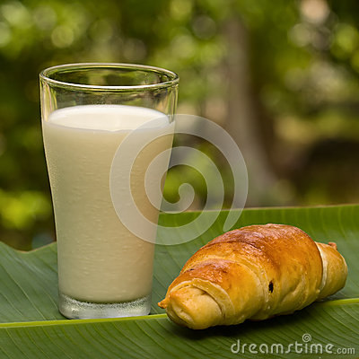 Glass of milk and croissant