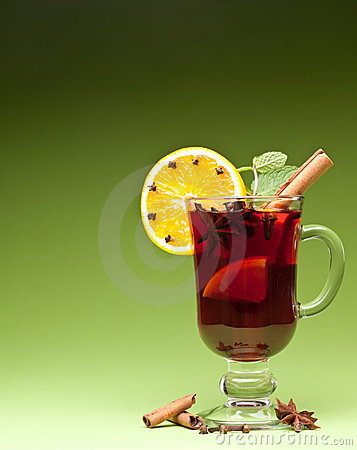 Glass of mulled wine on a green