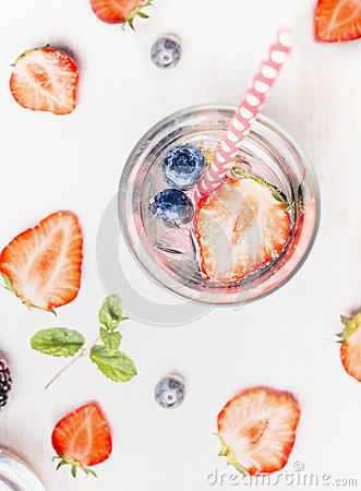 Free Glass Of Detox Drink With Infused Water , Fresh Berries , Ice Cubes And Mint Leaves Stock Photo - 72396120