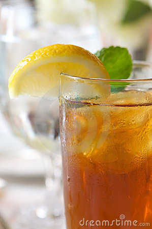 Free Glass Of Ice Tea On A Sun Drenched Table Royalty Free Stock Images - 4803519