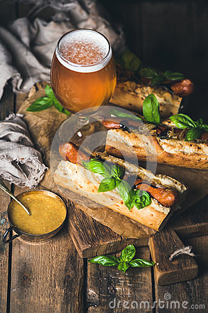 Free Glass Of Wheat Beer And Grilled Sausage Dogs In Baguette Stock Images - 77122534