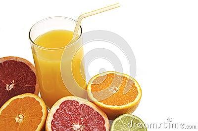 Glass of orange juice with fresh fruits.