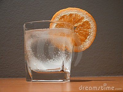 Glass and orange slice
