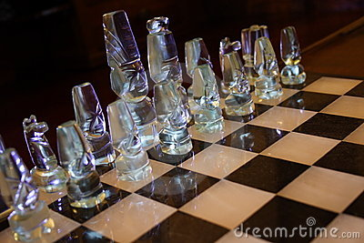 Glass pieces on chessboard