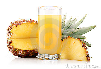 Glass of pineapple juice with fruit