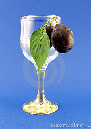 Glass with plums