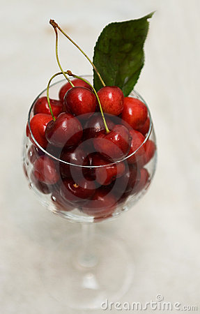 Glass of red cherries