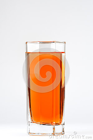 A glass with a red drink