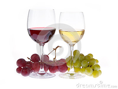 Glass of red and white wine with grapes