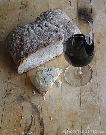 Glass of red wine, blue cheese