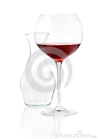 Glass of red wine with carafe