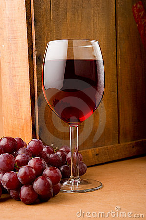 Glass of Red Wine with Grapes