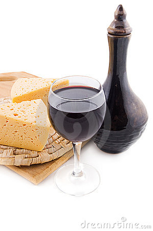 Glass of red wine, jug and cheese