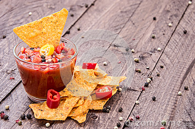 Glass with Salsa Sauce and Nachos