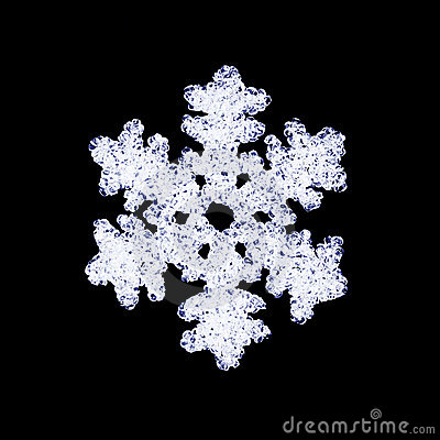 Glass snowflake on black