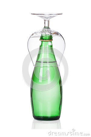 Glass of soda water bottle  on white