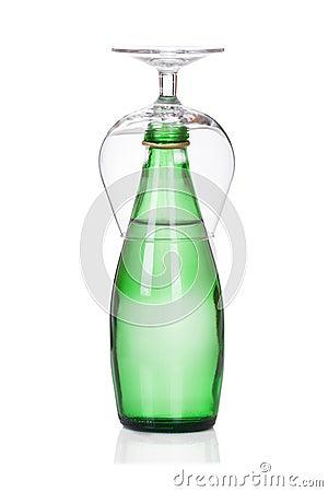 Glass of soda water bottle  on white