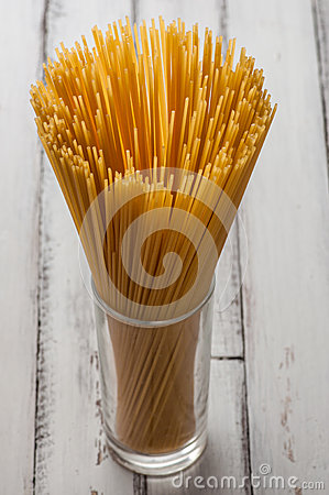Glass with some dry spaghetti