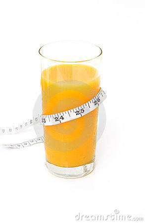 Glass of tasty orange juice with measuring tape